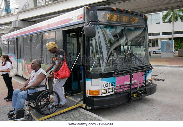 Miami Florida Omni Bus Station Metrobus public transportation mass transit bus stop electric wheelchair disabled - Stock Image
