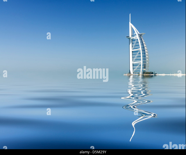 Reflection of luxury Burj al Arab Hotel on beach front in Dubai United Arab Emirates UAE - Stock-Bilder