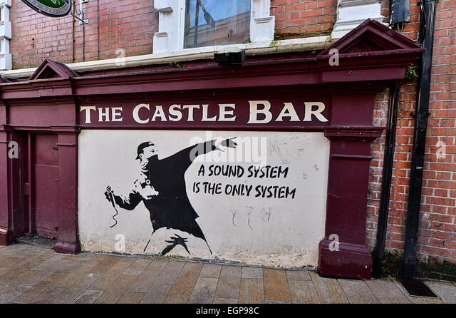 A mural by banksy stock photos a mural by banksy stock for Banksy mural sold