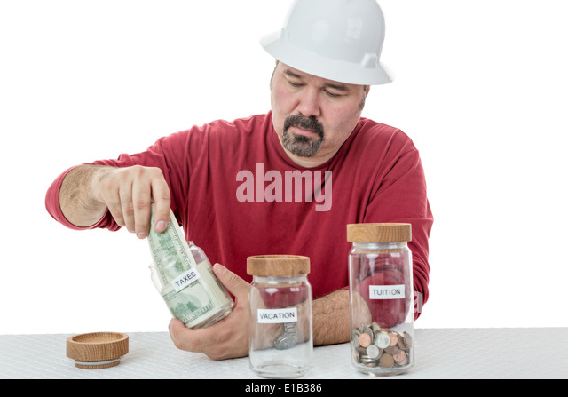 Unhappy construction worker destining all the money to taxes and left with coins for tuition and none for vacations - Stock Image