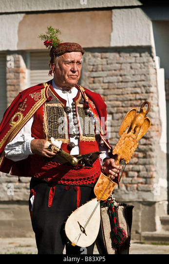 Old man in the traditional Croatian folklore costume - Stock-Bilder