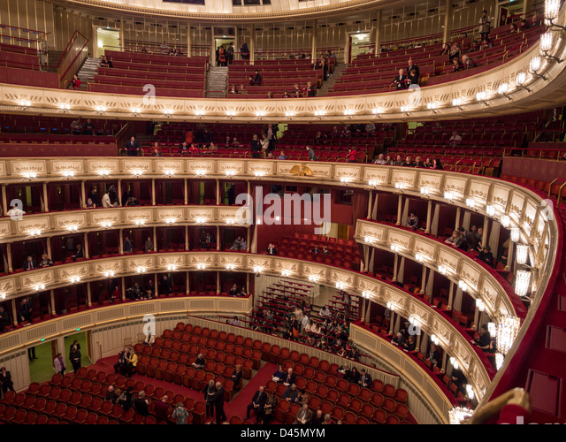 Opera Patrons Gather for a night at the Opera. Most of the red balcony and even standing room places are still empty - Stock Image