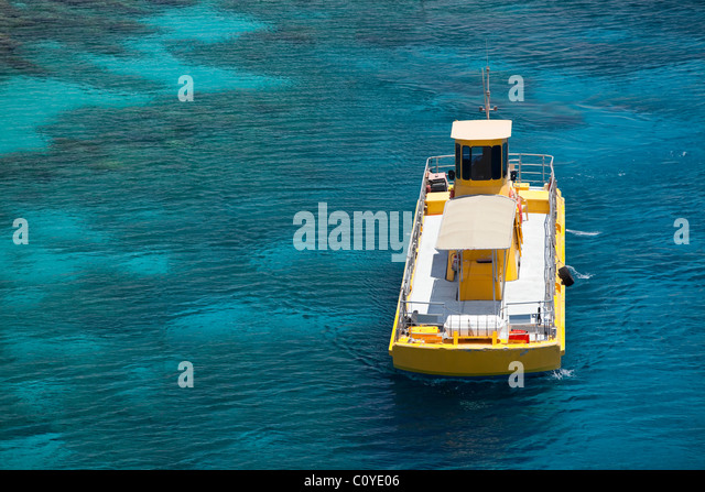 The south of Israel Eilat city a yellow boat in the sea - Stock Image