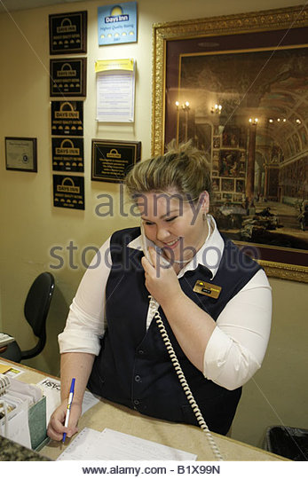 Arkansas Pocahontas Days Inn motel woman front desk clerk job public hospitality industry computer monitor register - Stock Image