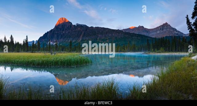 Sunrise over Mount Chephren & Epaulette Mountain from Mistaya River, Banff National Park, Alberta, Canada - Stock Image