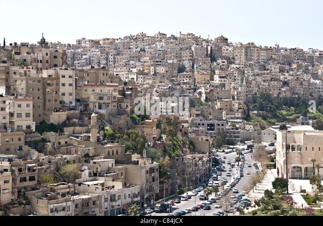 A view of a main road and residential homes in downtown Amman, in the Hashemite Kingdom of Jordan. - Stock Image