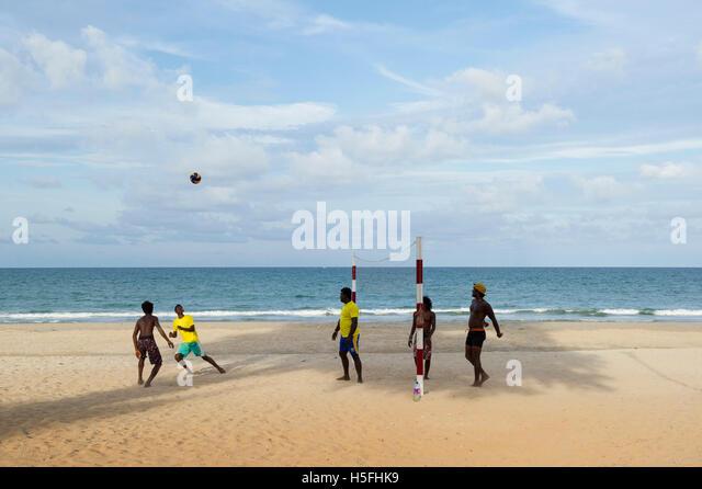 Volleyball game on the beach, Trincomalee, Sri Lanka - Stock Image