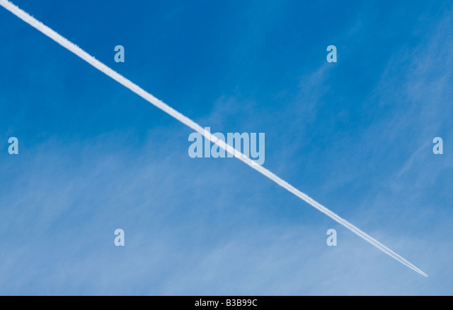 Contrail or vapour trail in the sky from a jet plane - Stock Image