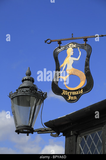 A sign outside the historic Mermaid Inn at Rye, one of the oldest Inns in England. - Stock Image