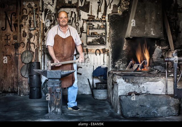 Portrait of senior male blacksmith in traditional workshop, Cagliari, Sardinia, Italy - Stock-Bilder
