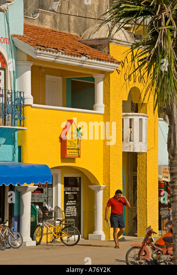 Cozumel Mexico San Miguel town skyline bright yellow colorful buildings - Stock Image