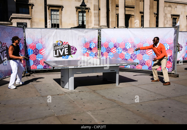 People playing outdoor Table Tennis in London - Stock Image