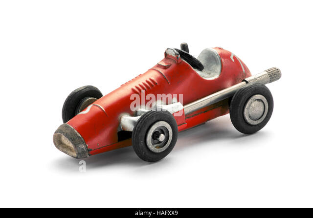 Vintage red toy racing car, side view on white background - Stock Image