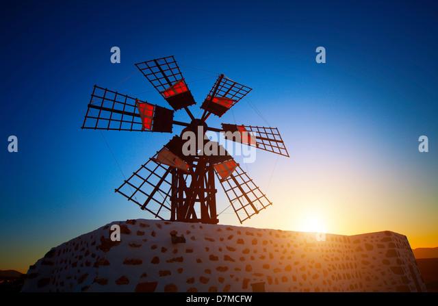 Windmill at sunset - Stock-Bilder