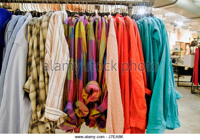 Miami Beach Florida Collins Avenue shopping Urban Outfitters retail display for sale women's clothing shirts - Stock Image