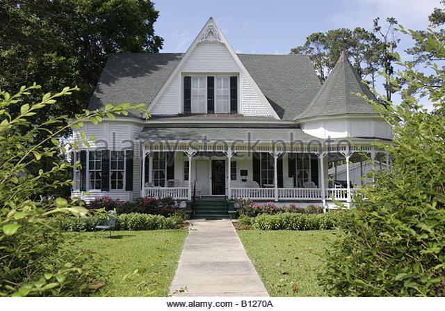 Monroeville Alabama Pineville Road historic homes Stallworth home Queen Anne columns wraparound porch turret gabled - Stock Image