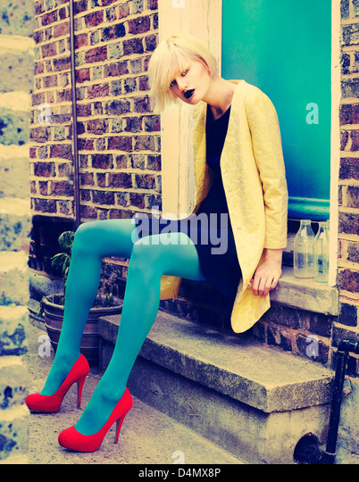 blonde girl in the street - Stock Image