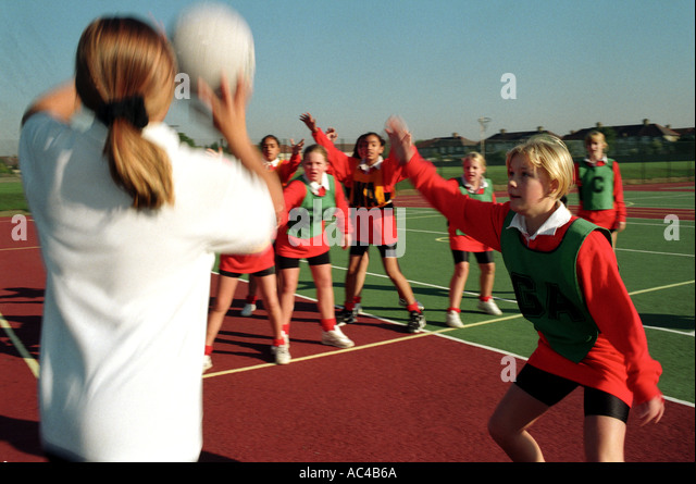 Females playing Basketball / netball at a secondary school - Stock Image