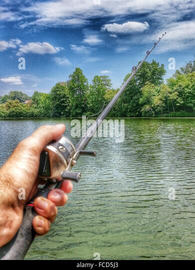 Young Man Fishing In River - Stock Image