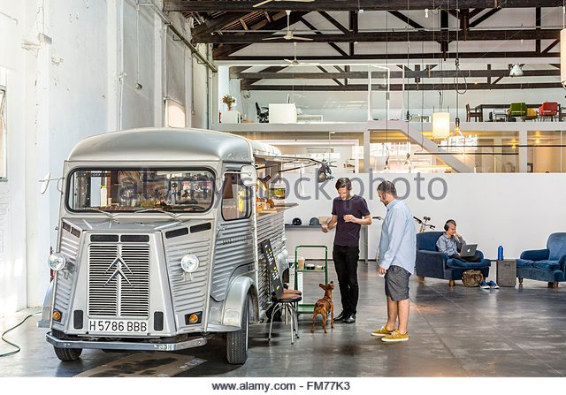 Spain, Catalonia, Barcelona, Poblenou, Espacio 88 coworking space with the food truck Skye Coffee Co. installed - Stock Image