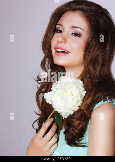 Freshness. Happy Woman with Peony Flower Smiling - Stock Image
