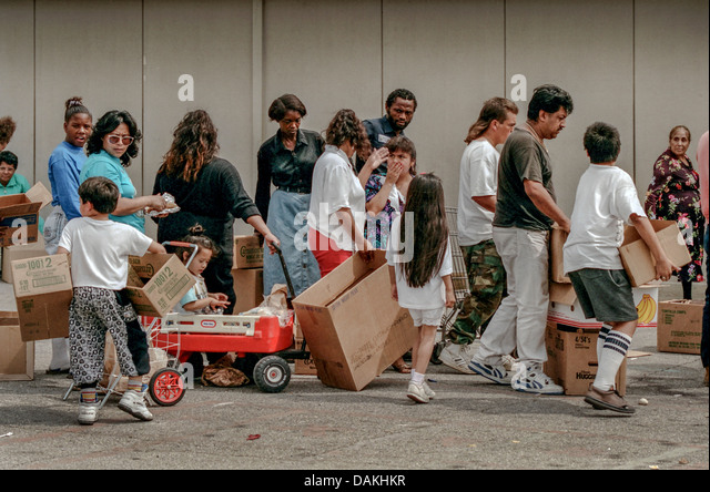 Hungry Hispanic and African American local LA residents line up for free charity food after the 1992 Rodney King - Stock Image
