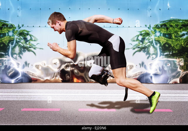 Explosive sprint of male athlete on road surface with strong reflecting metal background. Filtered version. - Stock-Bilder