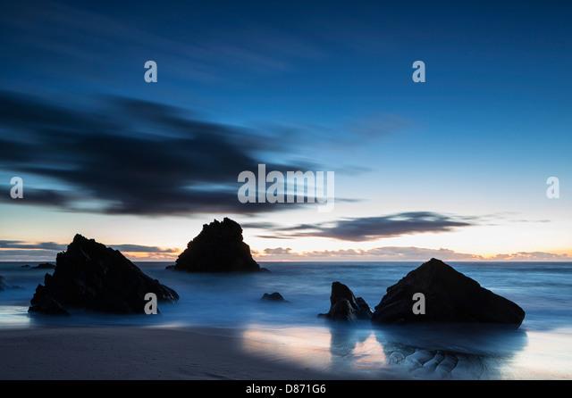 Portugal, View of Praia da Adraga at blue hour - Stock Image