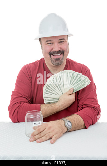 Happy construction worker wearing a hard-hat holding-on to dollar notes destined to taxes - Stock Image