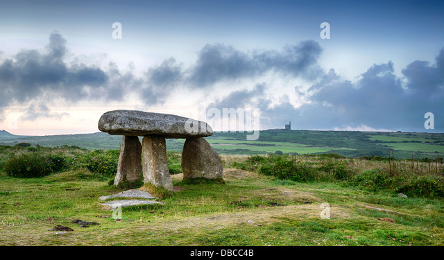Lanyon Quoit near Madron on the Lands End Peninsula in Cornwall, with a Cornish tin mine in the distance. - Stock Image