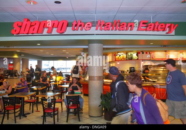 Charlotte North Carolina Charlotte Douglas International Airport CLT terminal concourse gate area Sbarro Italian - Stock Image