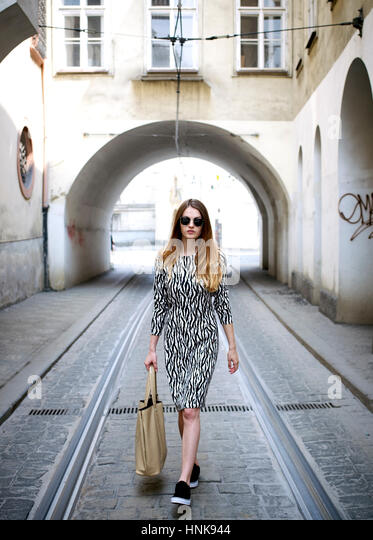 street portrait of young woman in Prague, Czech Republic. - Stock Image