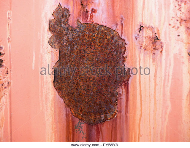 Oxidized and rusty metal plate. Abstract background. - Stock Image