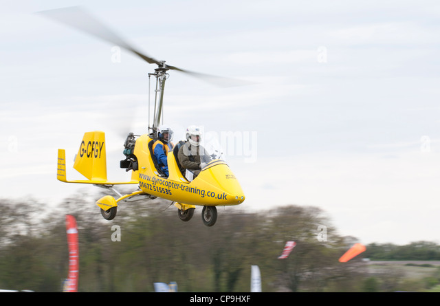 Rotorsport Gyrocopter lifts off for an air experience flight at Popham airfield near Basingstoke, Hampshire, England - Stock Image