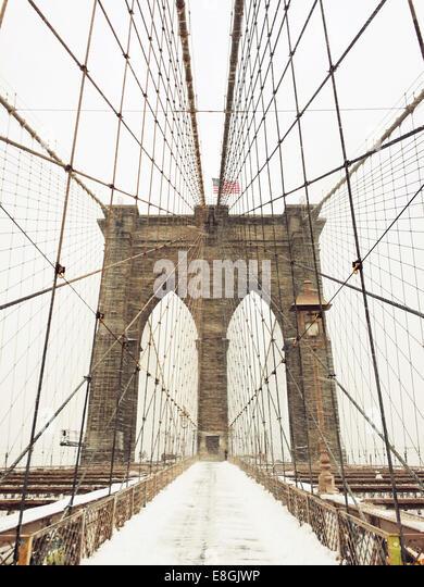 Brooklyn Bridge in snow, New York, America, USA - Stock Image