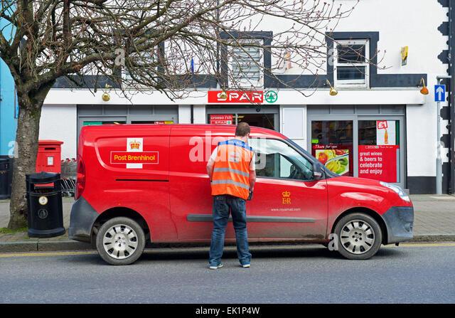 Postman and Royal Mail van - Stock Image