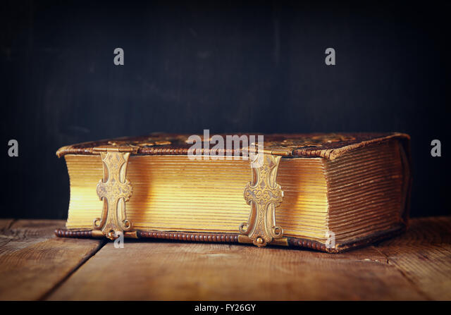 low key image of antique story book. vintage filtered. selective focus - Stock Image