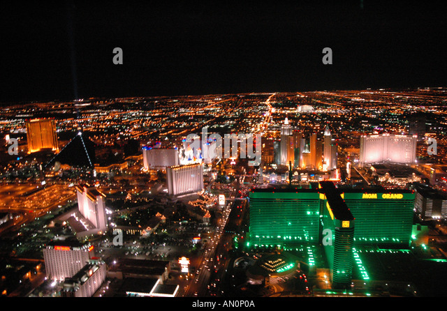 aerial above Las Vegas Nevada at night bright neon lights - Stock Image