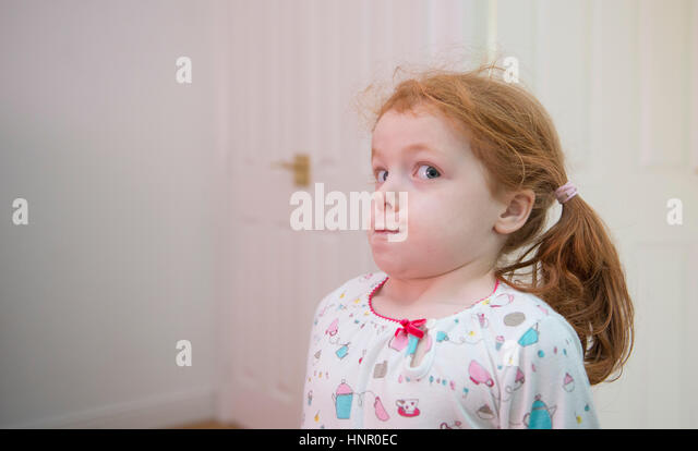 A little girl holding her breath - Stock Image