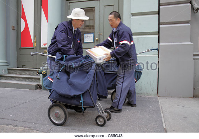 Lower Manhattan New York City NYC NY SoHo Broome Street Asian man men mailman letter carrier postie USPS postal - Stock Image