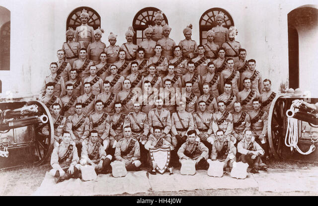 Group photo, No. 4 Mountain Battery Royal Garrison Artillery cricket team with sports shields and guns, Rawalpindi, - Stock Image