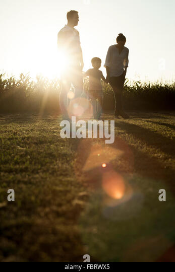 Family with little boy enjoying great outdoors - Stock Image