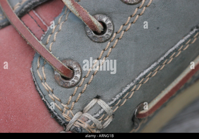 close up of red and green deck shoe with stitching - Stock Image