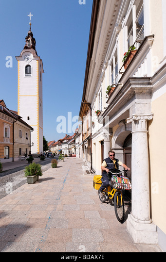 The street Sutna and the Church of the Immaculate Conception, Kamnik, Gorenjska, Slovenia. With Postman. - Stock Image