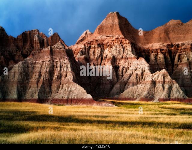 Grass meadow and colorful rocks. Badlands National Park, South Dakota. - Stock Image