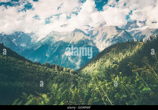 Mountains and forest Landscape in Abkhazia with cloudy sky Summer Travel scenic view - Stock Image