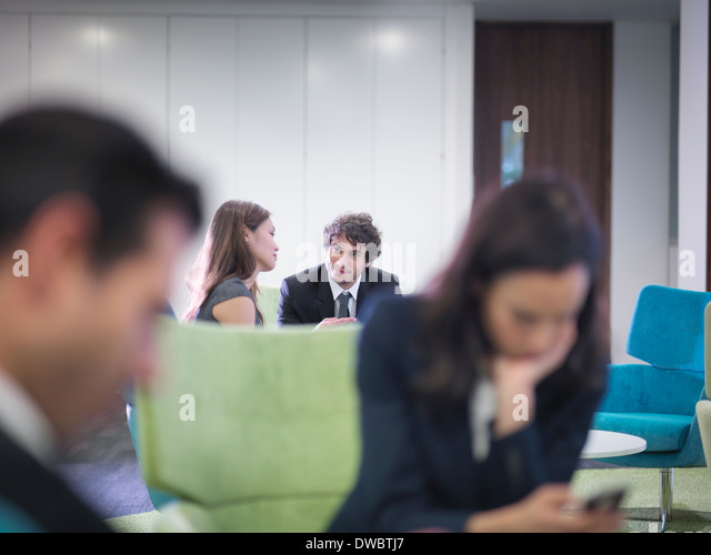 Business colleagues in meeting in office - Stock Image