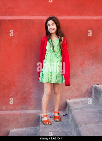 portrait of colorfully dressed young girl - Stock Image