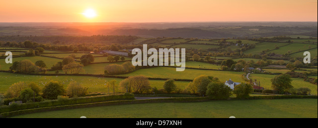 Sunset over beautiful rolling Devon countryside, Devon, England. Summer (June) 2013 - Stock Image