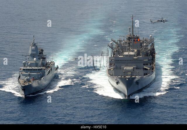 The German navy frigate FGS Hamburd (F220) and the Military Sealift Command fast combat support ship USNS Bridge - Stock Image